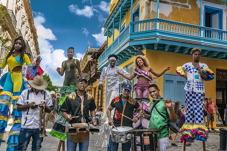 Cuban stilt dancer musicians.