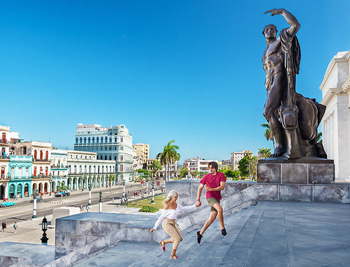 Cuba youth play on the steps of Havana's Capitol building.